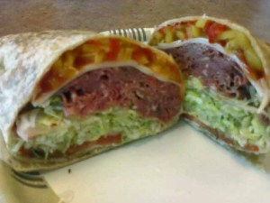 top to bottom banana and red peppers, chedder cheese, roast beef, lettuce, tomato