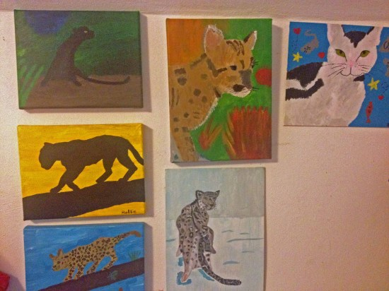 "I do like to paint.   I call this wall  ""Wall of cats""."
