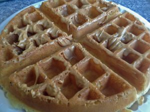 Waffle topped with peanut butter/syrup.