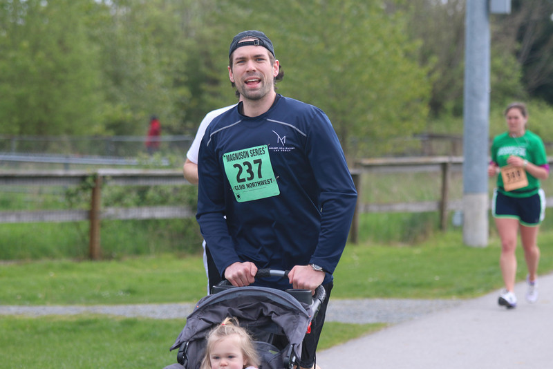 My oldest brother Doug running pushing his daughter.