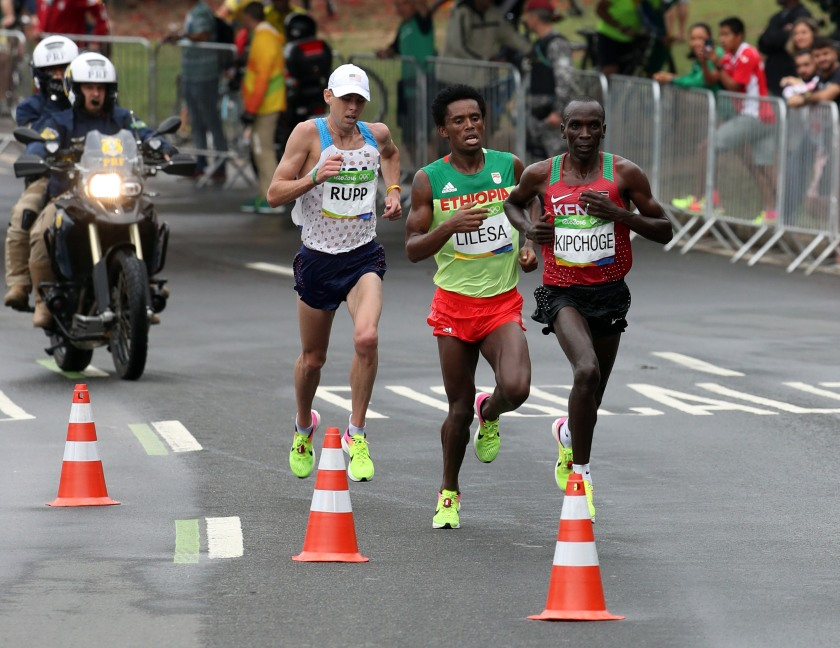 Aug 21, 2016; Rio de Janeiro, Brazil; Eliud Kipchoge (KEN) , Feyisa Lilesa (ETH) and Galen Rupp (USA) race during the men's marathon in the Rio 2016 Summer Olympic Games at Sambodromo. Mandatory Credit: Eric Seals-USA TODAY Sports